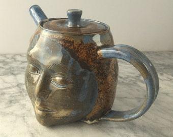 Teapot face sculpture pottery head smile, ceramic art porcelain vessel bust blue glazed portrait