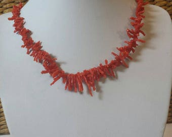 A red coral Pentacle choker necklace sure to put some pizzazz in your day