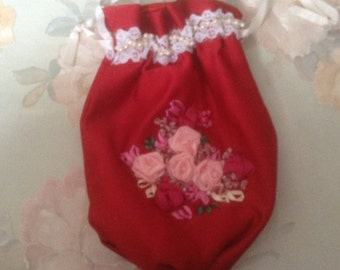 Victorian pull string handle with hand embroidered flowered front