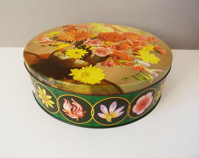 Vintage flowery cake tin