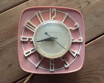sweet pink 50's kitchen wall clock - it works!  made by  General Electric