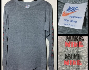 1970's super soft paper thin Long printed Sleeves Nike brand block letters Orange Tag T-shirt size Medium 18x25 heather Gray made in USA