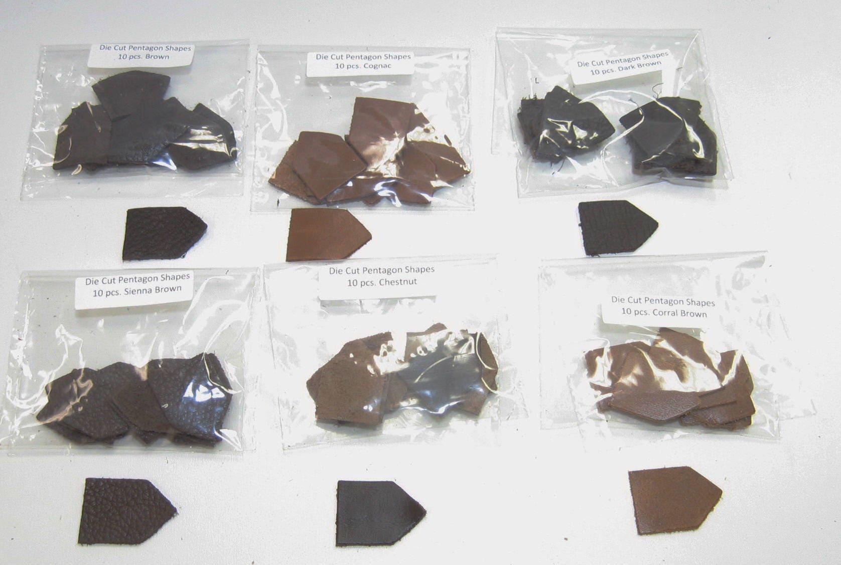 Leather die cut house shapes crests pentagons 10 pcs for Leather shapes for crafts