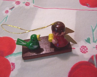 itty bitty ornament with tiny green bird