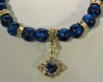 Dark Blue Beads with Rhinestone Spacer Beads and a Charm Stretchy Bracelet