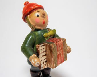 Adorable Chippy Wood Accordian Player Figure