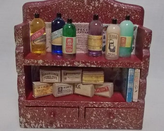Dolls House Miniature small red /gold potion/poison plant extract display (A)