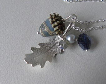 Silver oak leaf and grey blue glass acorn necklace