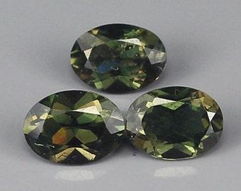 KORNERUPINE  (32294)  Parcel (3 small gems) Oval Kornerupine - Madagascar-Mined