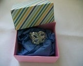 A very pretty ring made from vintage demitasse spoon. It comes in a free hand crafted box