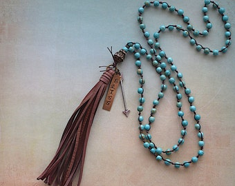Blue Howlite Knotted Beads / Brown Deerskin Tassel / Hand Stamped Bliss Tag / Necklace