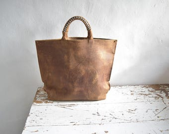 Large Leather Tote in Distressed Natural Brown and Woven Top Handles.  Lined with pockets.