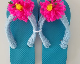 Ladies Turquoise  Flip Flops with Blue Crocheted Straps, Shocking Pink Pom Poms and Yellow Rose