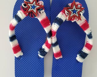Ladies/Women Blue Flip Flops with Crocheted Red,White and Blue Straps, Pom Poms and Glitter Star