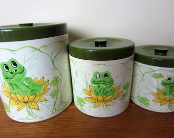 1977 Sears Roebuck and Co. set of 3 plastic frog canisters with avocado green lids.  Lily pad and frog canisters circa 1970s