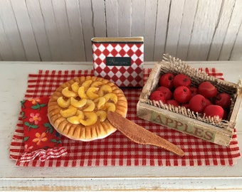 Miniature Apple Pie, Crate Of Apples, Cookbook, Cute Kitchen Towel, And Wood Serving Knife