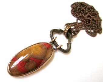 Someone's Gotta Sing the Pain - long primitive industrial red orange mustard poppy jasper, vintage verdigris connector, metalwork pendant