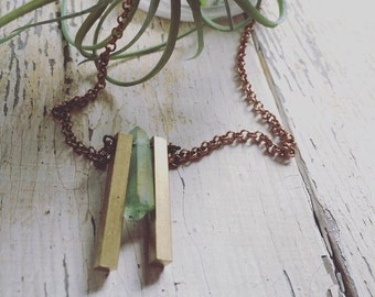 Green or Clear quartz nestled between two brass bars / necklace / abstract / geometric