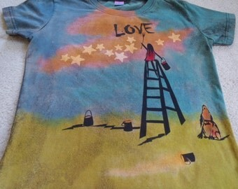 Variation on who paints the stars? She is painting the stars and spreading the love, woman's  medium t-shirt, discharged & silk screened