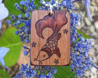 "Koi on Cherry Wood Pyrography Woodburning Pendant 1.5""x1"""