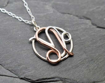 Leo capricorn zodiac necklace sterling silver and polished copper