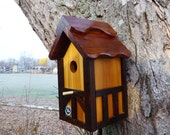 Birdhouse painted,outdoor wood, Nesting Box,Thatch roof style, cedar wood,natural body Tudor style,EZ clean Handmade in USA fully functional