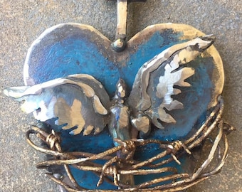 RELEASED, sacred heart sculpted from junkyard metal