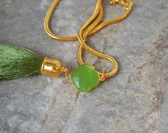 Sophisticated gemstone tassel necklace Natural chalcedony clover shaped pendant Green silk tassel pendant on gold chain Pantone greenery