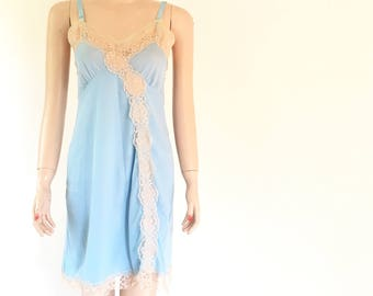 Pale blue dress slip, ivory lace accents, all nylon, size small