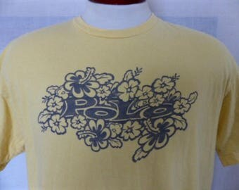 rare vintage 90's Ralph Lauren Polo Sport light yellow graphic t-shirt gray hibiscus flower logo print crew neck loose boxy oversized medium