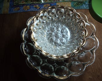 Serving and sauce bowls in clear depression glass  with gold trim