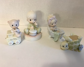 collection of 4 Precious Moments Figurines