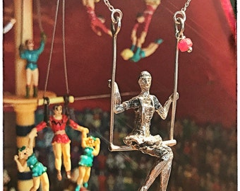 Hanging Dancer Circus sitting on trapeze. Silver Hanging Circus dancer. Trapeze pendant. Trapeze necklace. Silver necklace.