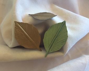"""2"""" metallic leather steam leaves."""