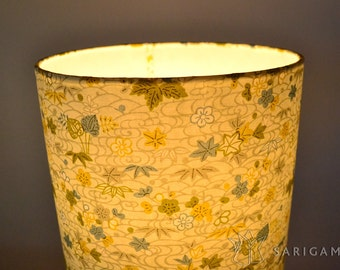 Lampshade handmade with japanese paper with a delicate design in pale colors
