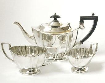 Art Deco silver plated tea set, EPNS teapot, Sugar bowl creamer milk jug, Pedestal base, Fluted edges, Bakelite handle and finial