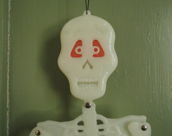 Small Skeleton, Flashing eyes, Movable parts, Glow-in-the-dark, Halloween greeter, Articulated skeleton, Vintage