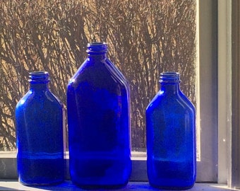 Three vintage cobalt blue bottles old milk of magnesia bottle