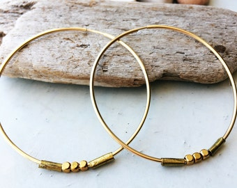 Simple gold hoop with handmade accents.