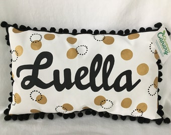 Pillow with gold and black polka dots and name in black