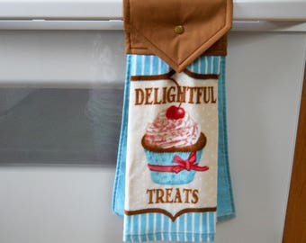 """Lovely hanging kitchen towel with """"Delightful treats"""" on the front."""
