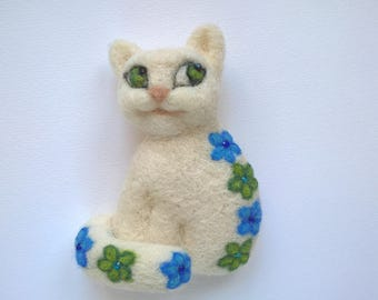 Needle felted cat brooch, white, flower, blue, green