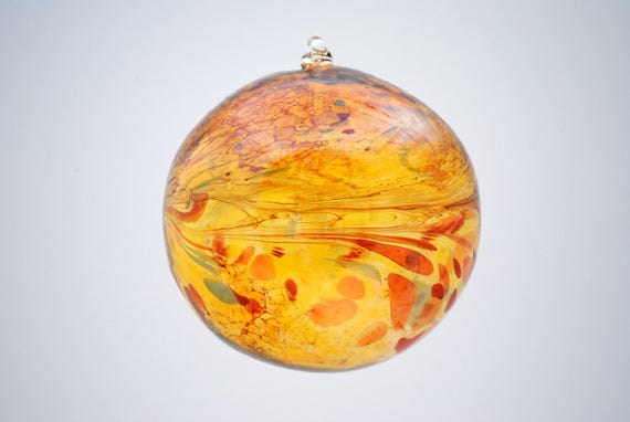 e00-64 Extra Large Iridescent Ornament Gold with colorful chips melted on top