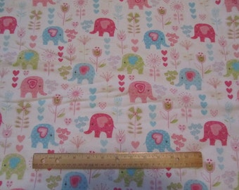White with Pastel Colored Elephants and Flowers Flannel Fabric by the Yard