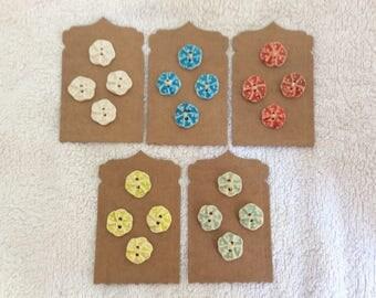 Handmade porcelain buttons .