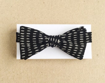 Black Bow Tie with Small White Dashes