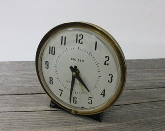 Vintage Big Ben wind up alarm clock with white face and metal body. Over-wound, does not work but great for parts or vintage decoration