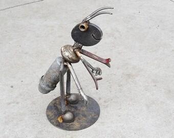Welded Ant garden art made of salvaged steel.