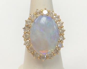 Stunning Oval Opal Ring with Diamond Halo - 2.16 Carats Total Diamond Weight