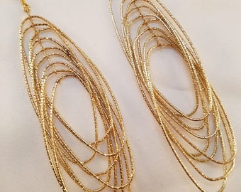 Bright gold oval dangle earrings